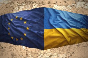 Waving Ukrainian and European Union flags of the political map of the world